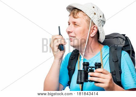 Happy Traveler With Walkie-talkie And Binoculars On A White Background