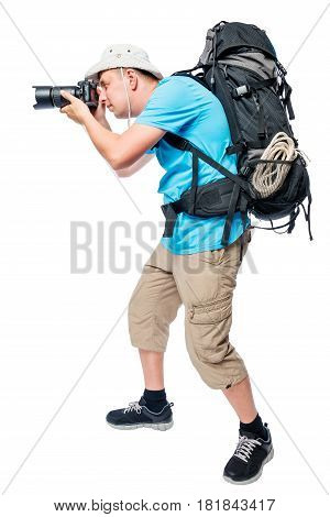 Photographer In Ambush With A Big Backpack On A White Background
