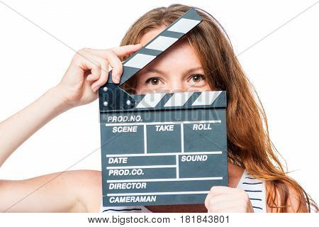 Close-up Of An Actress Looking After A Movie Clapper On A White Background