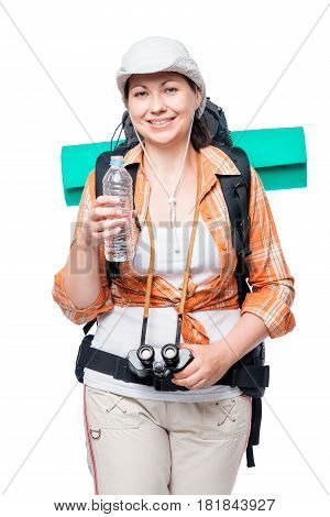 Portrait Of A Tourist With A Water Bottle And Backpack On A White Background