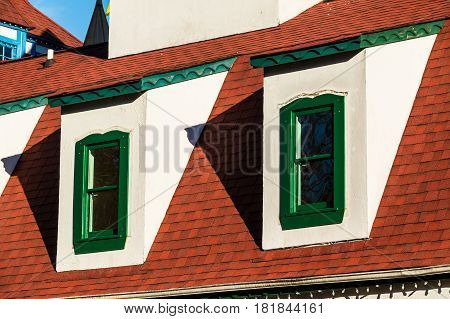 Two windows on the roof of attic in the house in German style Helen USA