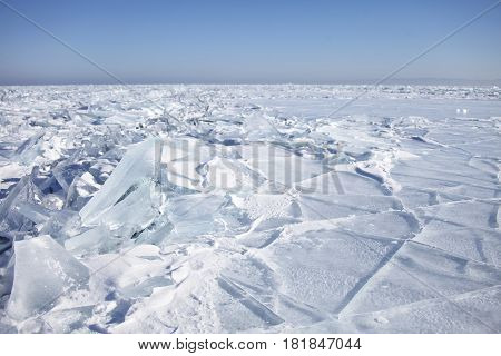 Pieces Of Ice, Hummocks Of Ice Of Lake Baikal. Winter Landscape