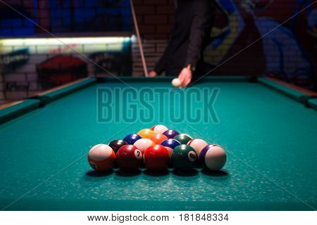 A Young Man Is Going To Play American Billiards Pool