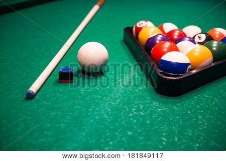 Billiard Balls Near By Cue And Chalk