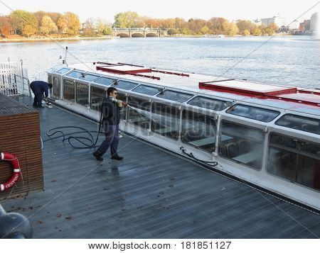 Washing A Ferryboat In Hamburg