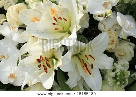 Big white lilies in a floral wedding decoration