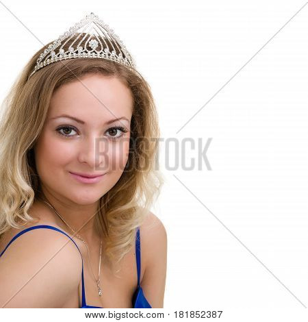 beautiful smiling girl with diadem on a white background