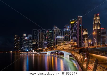 Singapore - April 14, 2017: Singapore skyline and illuminated financial district night view Downtown Urban cityscape of Singapore. Modern skyscrapers of business district Marina Bay