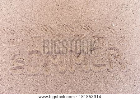 Word summer (Sommer) in german written on the beach