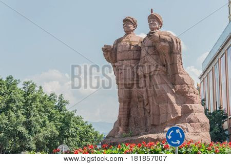 Sichuan, China - Sep 15 2014: Statues Of Liu Bocheng And Yi People In Xichang, Sichuan, China. He Is