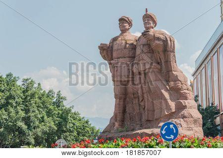 Sichuan, China - Sep 15 2014: Statues Of Liu Bocheng And Yi People In Xichang, Sichuan, China. He Is