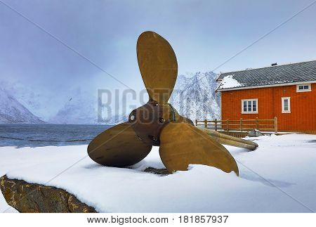 Ship propeller as a monument in the fishing village of Hamnoi Lofoten Islands Norway.