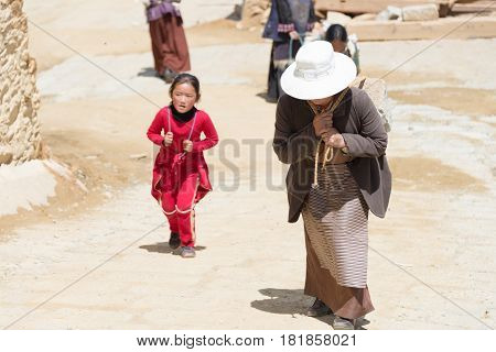 Litang, China - Jul 17 2014: Pilgrim At Ganden Thubchen Choekhorling Monastery (lithang Gompa). A Fa