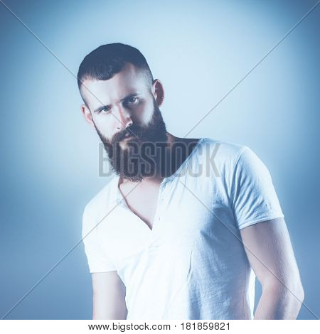 Portrait of handsome man standing, isolated on grey background