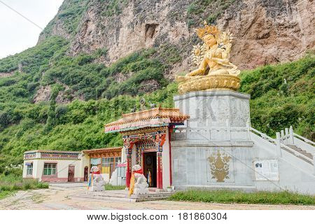 Huzhu, China - Jul 7 2014: Buddha Statue At Gonlung Champa Ling(youningsi). A Famous Monastery In Hu