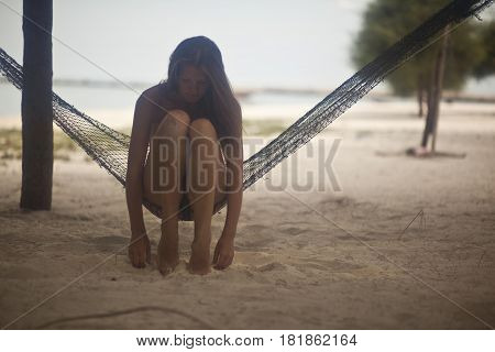 Woman Relaxing In Beach Hammock. Summer time