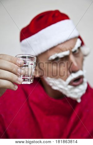 Portrait of a bad Santa Claus drinking vodka