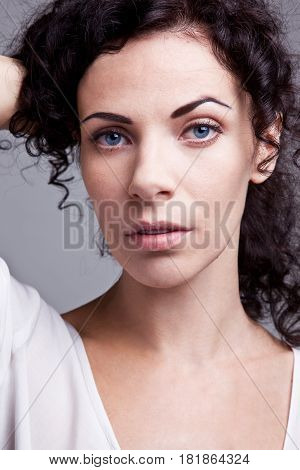 Beautiful Brunette nobel woman with curly hair