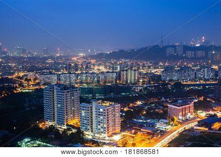 KUALA LUMPUR MALAYSIA - MARCH 15: Kuala Lumpur skyline at night on March 15 2016 in Kuala Lumpur Malaysia.