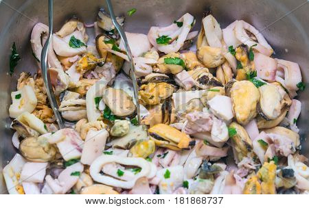 cooked seafood calamari and mussels as a background