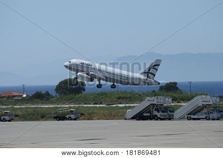 RHODES,GREECE 9 JUNE 2012: Aegean Airlines Airbus A319 landing at International Airport in Rhodes, Greece.