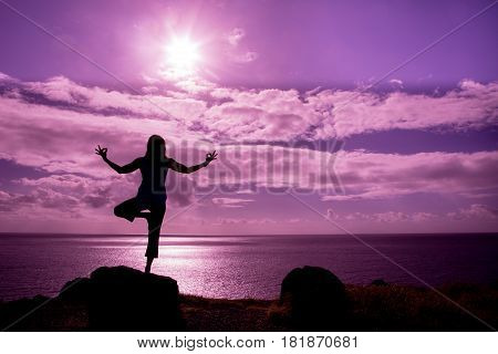 a woman practicing yoga on the Maui coast