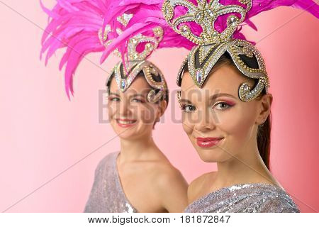 Beautiful Girls In Carnival Costume With Pink Feathers.