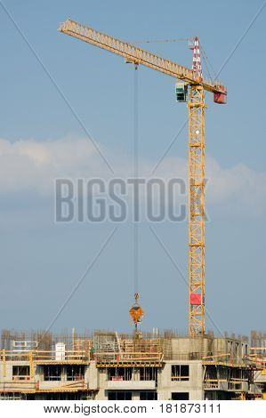 Large Yellow Crane On An Apartment House Construction Site