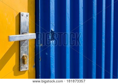 Bright yellow and blue painted door on a construction site