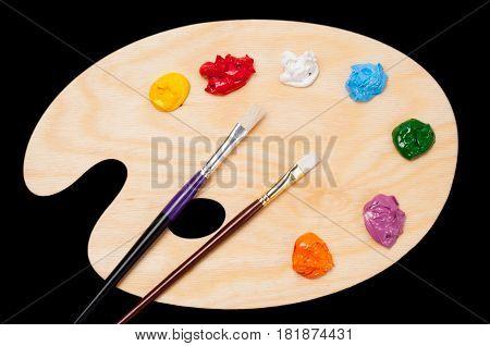 Artist's color palette with multi-colored oil paints