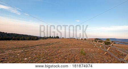Split Rail Fence at sunrise in the Pryor Mountains range on the Montana Wyoming state line USA