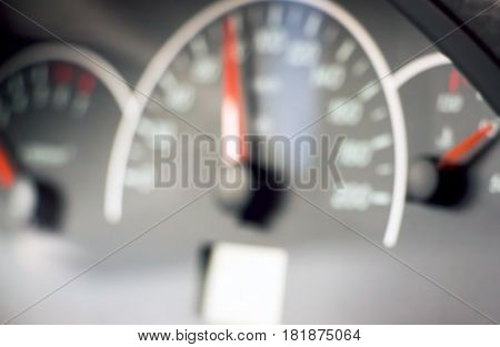Blurred photo of the speedometer in car Dashboard for the background