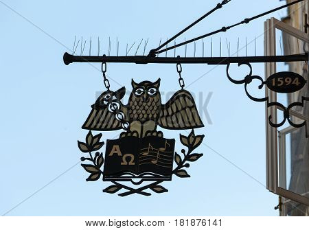 SALZBURG AUSTRIA - APRIL 29 2016: Wrought-iron guild sign hanging above a shop on Getreidegasse in Salzburg