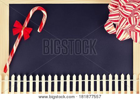 Christmas decorations on vintage wooden blackboard. Close up.