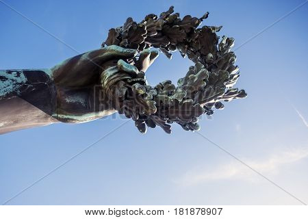 Detail Of The Hand Holding A Laurel Wreath From The Bronze Sculpture Of The Patron Saint Of Munich,