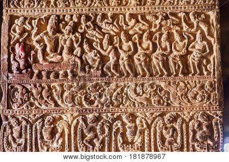 Hindu lord Shiva and his wife Parvati, as well as many servants on a column with carved patterns inside the 7th century temples in Pattadakal, India. UNESCO World Heritage site