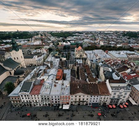 Panorama of the city of Lviv view from above of the City hall. Roofs of buildings in the center of market square at sunset Lviv Ukraine.