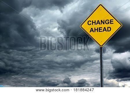 change ahead warning sign in front of storm cloud