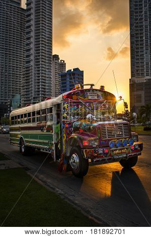 Panama City Panama - March 18 2014: Colorful bus in an avenue in the downtown of Panama City in Panama at sunset.