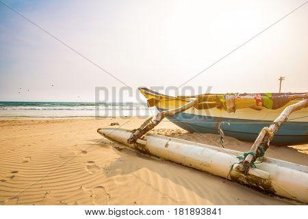 Fishing boat and sandy beach on Sri Lanka