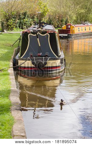 Barges moored up on the Shropshire Union canal a popular holiday getaway and alternative lifestyle on the rural inland waterway network