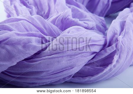 Close up of soft purple semitransparent wrinkled fabric on white background