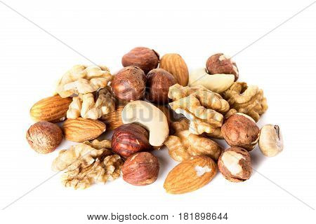 Heap from various kinds of nuts almond walnut hazelnut cashew Brazil nut isolated on white background.