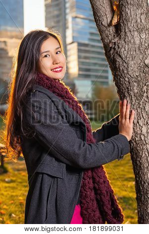 Smiling Girl Posing Near The Tree