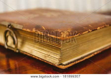 Antique leather-bound book, selective focus on Corner of the book