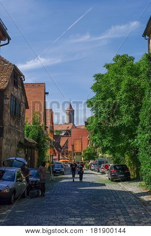 Dinkelsbuhl, Germany - August 28, 2010: Street view of Dinkelsbuhl one of the archetypal medieval towns on the German Romantic Road.
