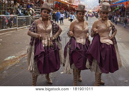 ORURO, BOLIVIA - FEBRUARY 26, 2017: Morenada dance group in colourful outfits parading through the mining city of Oruro on the Altiplano of Bolivia during the annual Oruro Carnival.