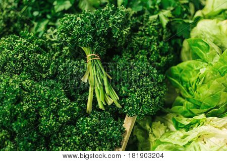Parsley. Greengrocery on the farm market. Natural local products on the farm market. Harvest. Seasonal products. Food.