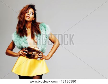 young pretty african-american woman posing in fashion clothers emotional, lifestyle people concept close up copyspace