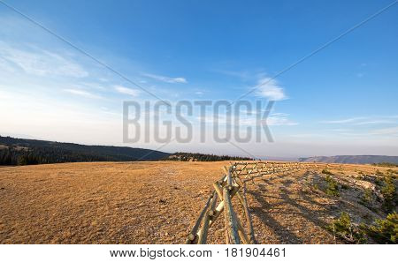 Split Rail Fence at sunrise above Lost Water Canyon in the Pryor Mountains Wild Horse range on the Montana Wyoming state line US